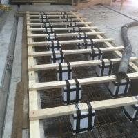 150mm steel cased mini piles and reinforcement cage in position for new machine base