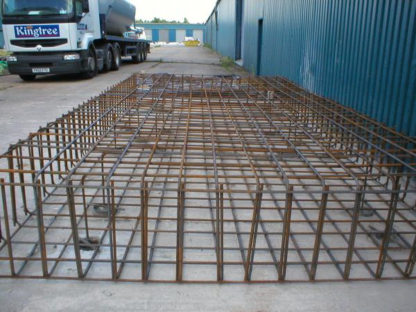 Steel Cased, 150mm Mini Piles and reinforcement cage to support new silos